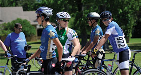 Sarah Cycles with Jesuit Cycling Team