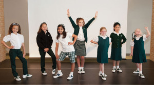 STRIKE A POSE Lower school students perform a fashion show showcasing uniform options for the next school year. Photo provided by Charlotte Hoskins
