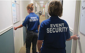 FEELING SECURE: Special event security guards Bobbie Odom and Morgan McCarty  double check dorm rooms to make sure all students have left for the school day. PHOTO BY ANITA WANG