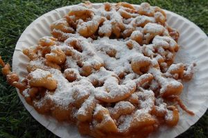 DELICIOUS FARE The funnel cakes at the State Fair of Texas cannot be missed. Enjoy them plain or with a variety of toppings. Photo by Erin  Thomas