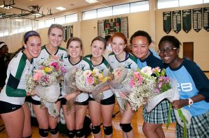 SPIRIT NIGHT Senior volleyball players (L to R) Lily Guevel, Madison Kaminski, Allie Love, Kelsey Powell and Christine Smith with senior managers Ashley Grey and Praise Owoyemi on senior night. Photo provided by Susan Kaminski