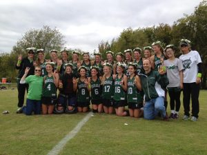 KILLER DAISIES The Hockaday Varsity Field Hockey team won third place at SPC. They pose in their daisy wreaths along with Headmistress Kim Wargo and Upper School Head John Ashton. Photo provided by Sarah Wechsler