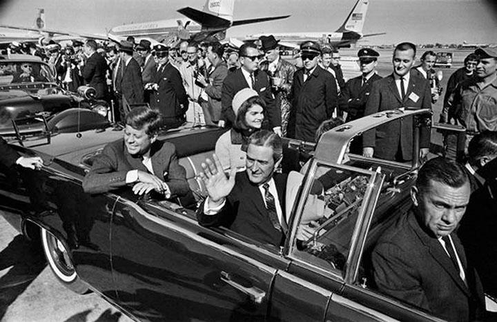 BELOVED PRESIDENT President John F. Kennedy and First Lady Jacqueline Kennedy Onassis in her iconic pink Chanel suit arrive at Love Field Airport in Dallas the morning of Nov. 22, hours before Kennedy's assassination. Photo provided by Tom Dillard of The Dallas Morning News