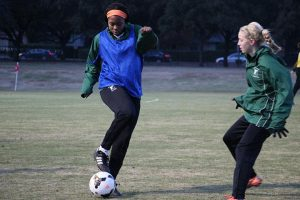 SPRINTING TO THE GOAL  Junior Mimi Asom (L) is being recruited by Divison I schools for soccer. PHOTO BY CLAIRE FLETCHER