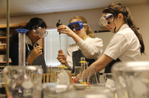 BETTER SAFE THAN SORRY  Seniors Shivani Sharma, Katherine Magee and junior Holly Haley don safety goggles in an Organic Chemistry class to ensure lab safety. Photo by Mary Clare Beytagh
