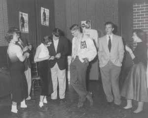 """ON FIRE (above) The Class of 1955 dances at the 1953 Christmas Formal: """"Fireman's Ball."""" Held in Tarry House, the Fireman's Ball was adorned with firetrucks, hoses and a large sun hanging from the ceiling. Instead of just bringing one date, students would invite several boys. For each dance, a boy would sign his name on a girl's dance card, which were in the shape of a fireman's ladder. If a young man wanted to """"borrow"""" a dance, he would simply """"cut in"""" by tapping on a girl's shoulder. Photo provided by Schatzie Lee"""