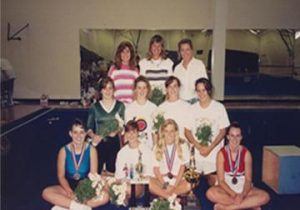 BRINGING HOME GOLD The gymnastics team with Barby Power (top middle) poses with their trophies after a meet in 1989. PHOTO PROVIDED BY BARBY POWER