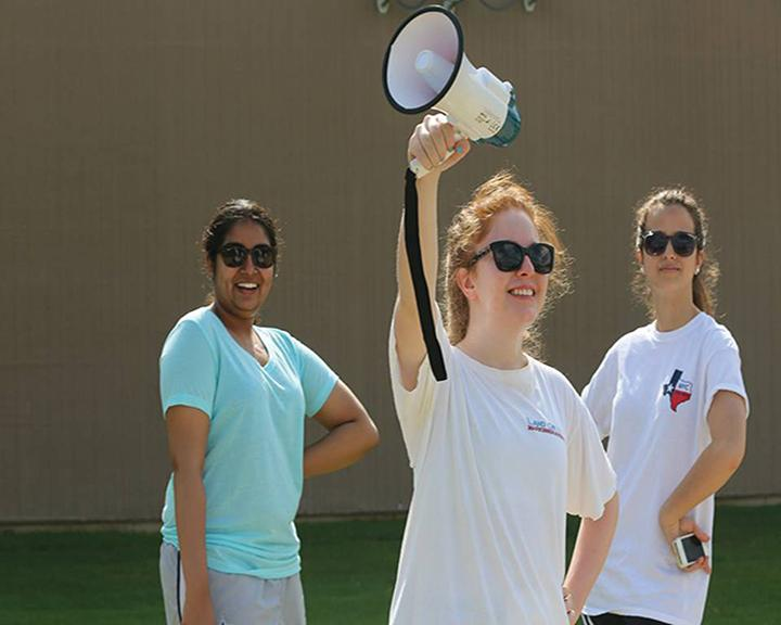 PAPERING THE TOWN Senior Bridget Colliton and Battleground Texas volunteers spread Wendy Davis campaign awareness around Dallas last August. PHOTO PROVIDED BY BRIDGET COLLITON