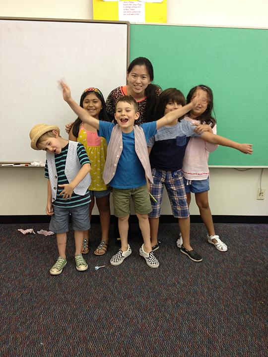 DARE TO LEARN Jiang poses with her students on the last day of class. PHOTO PROVIDED BY CATHERINE JIANG