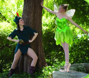 CAPTION: FLY TO NEVERLAND Senior Kathryn Shultz as Peter Pan and Senior Ripley Mayfield as Tinkerbell pose in Neverland's woods.