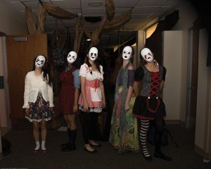 SILENT STARES Seniors Snow Zhou, Shriya Das, Sarah Zhou, Leah Cohen and Mary Zhong are dressed as dolls to portray the American Horror Story theme. PHOTO PROVIDED BY CHARLOTTE HOSKINS