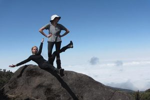 ON CLOUD NINE McManemin and her sister, Audrey McManemin, strikes a pose on their way to the top of Mount Kilimanjaro