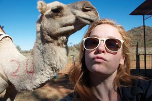 CAMEL-FLAGE McManemin blends in and interacts with animals during her stay in Australia.
