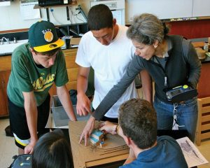 HARD HATS Susi Marzuola '78 teaches an architecture class to a group of students.