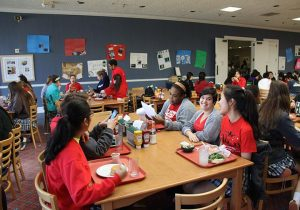 A SEA OF RED Upper School students get decked out in red shirts to celebrate National Wear Red Day. PHOTO CREDIT TO SONYA XU