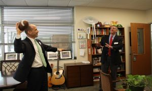 PASSING ON THE JOB Upper School Head passes off his job to Terry Murray, the Upper School Head effective in July.
