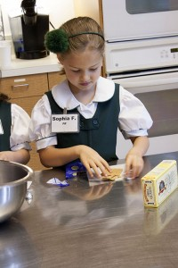 GIVE ME S'MORE Primer student Sophia Fagelman cooks up a storm in the Lower School Rotunda Learning Kitchen. Photo by Grace Voorheis