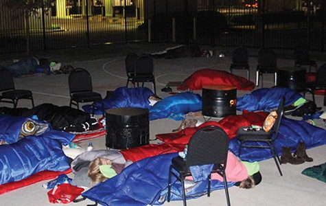 12 a.m. Nov. 19. Penelope Picagli, asleep in the center, simulated what it would be like to sleep on the streets. Photo provided by Promise House