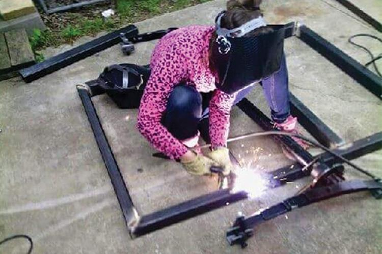 3:00 p.m. on a recent Sunday. Alumna Kelly Rae Potter welds one of her metal pieces. Photo provided by Kelly Rae Potter