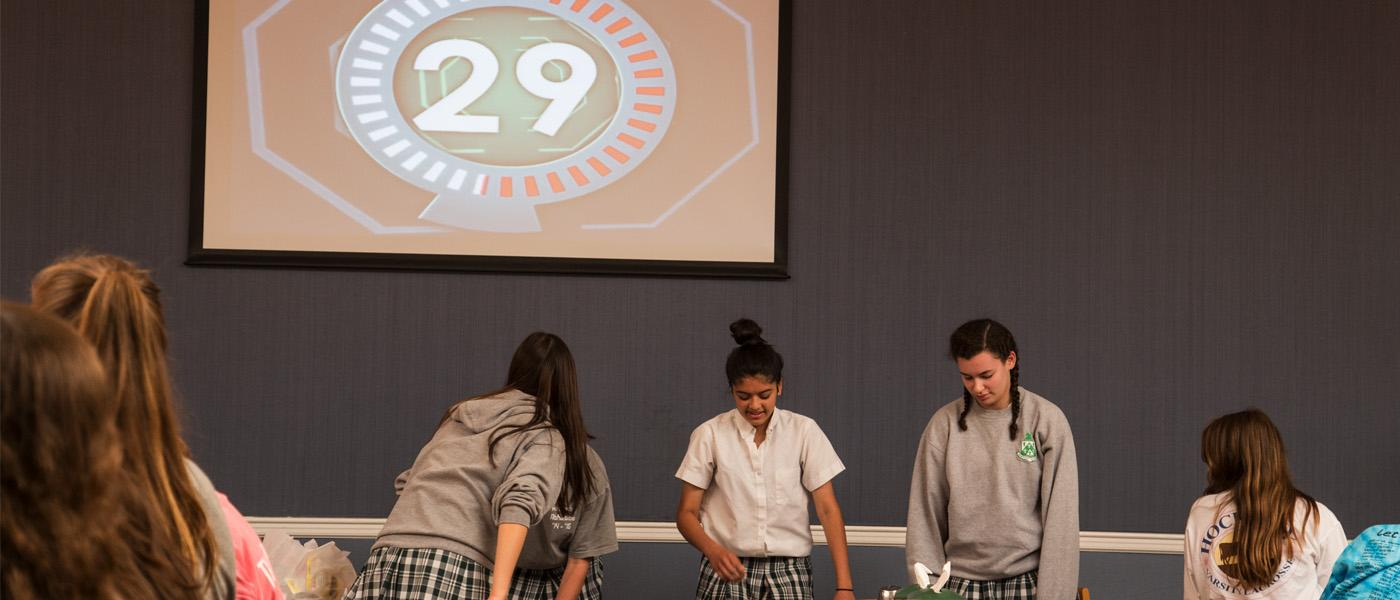 """Spring athletes compete in a """"Minute to Win it"""" game during lunch. //Photo by Katie O'Meara//The Fourcast"""
