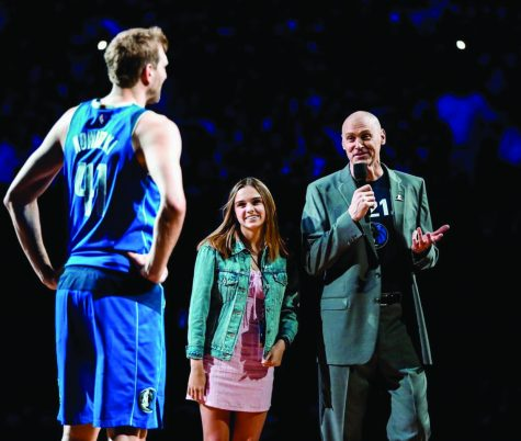 Abby attends a Maverick's game with her father last season.