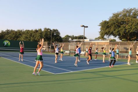 The drill team practices on the tennis courts in the morning, spread out to maintain social distancing. photo by Annie Herring.