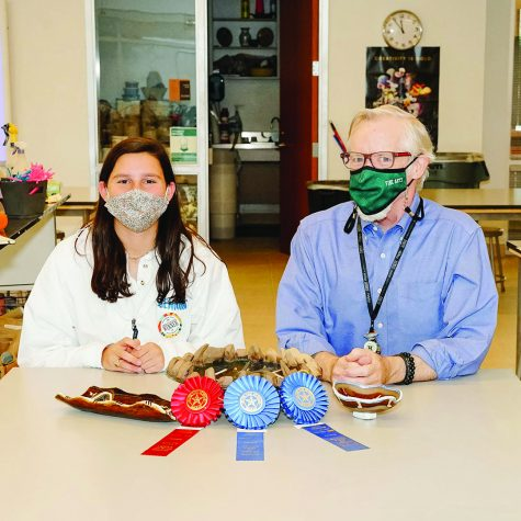 Isabel Malakoff and ceramics teacher Kevin Brady display Malakoff's ceramics pieces and the ribbons she won in the Texas State Fair contest. photo provided by Elizabeth Malakoff.