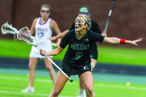 Junior Landry Grover plays a game of lacrosse. Currently, Grover is committed to the University of Denver. She says she is both excited and nervous to play on the collegiate level. photo provided by Landry Grover