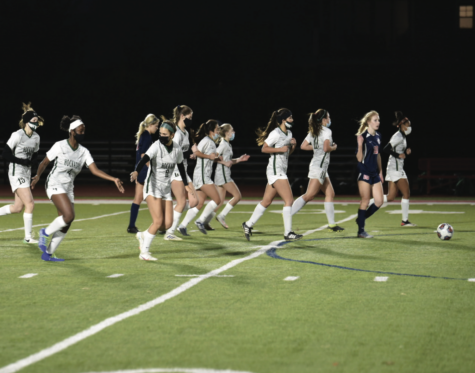 Varsity Soccer jogs back after scoring against Grapevine Faith. The team has played six SPC counter games during their season. Next year, they hope to be able to compete against South Zone teams. photo by Mia Salvodelli
