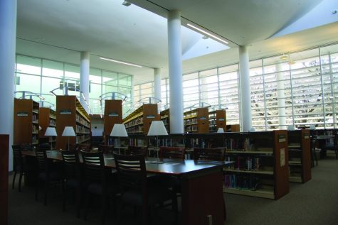 "A vacant table sits in the middle of the large, empty library. With its closure due to COVID-19, students are no longer allowed to use the space to sit and do work or browse the shelves for books. ""I really miss being able to use the library as a quiet and calm place to stay focused and study,"" junior Elise Little said."