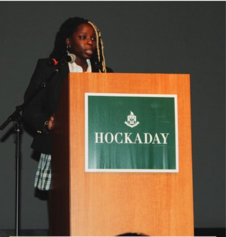 Financial Officer and Parliamentarian, Princess Ogiemwonyi, explains the new changes to the constitution at the Upper School welcome back assembly.