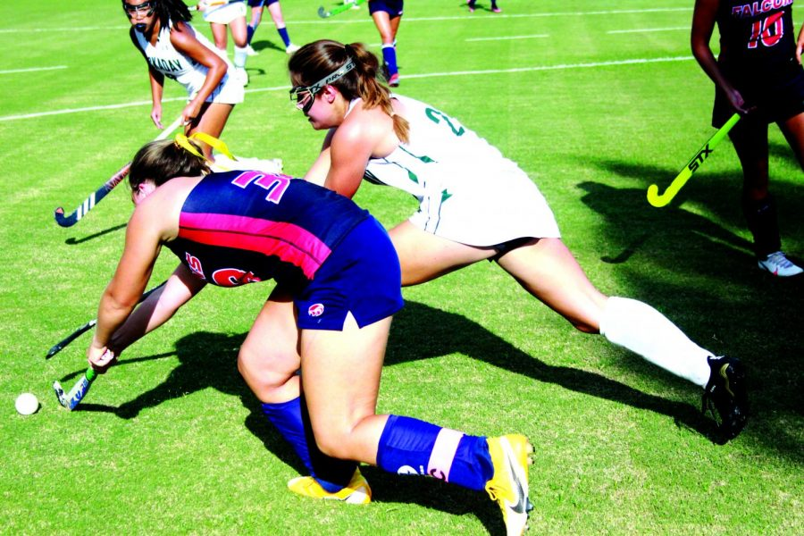 Senior Sydney Ghorayeb battles for the ball with a Fort Worth Country Day player.