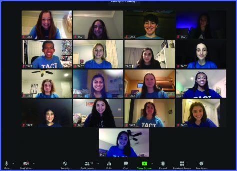 """Clad in matching blue T-shirts, members of TACT smiled for a Zoom photo after filming several skits to send to groups without access to live Zoom performances. """"Being virtual has been really cool because we got to perform for groups in other places we normally wouldn't get to, like Austin and Utah,"""" Ellis said."""